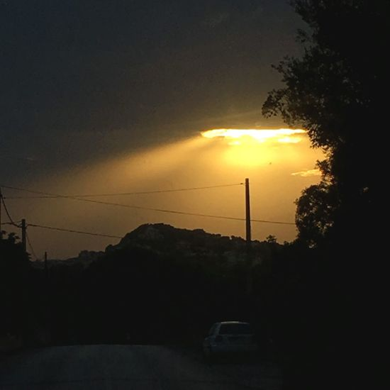 Skyhole Sun Sunset Nature Sky Car Tree Silhouette Mountain Crash Hole In The Sky Beauty In Nature No People EyeEm Ready   Ufo Signs