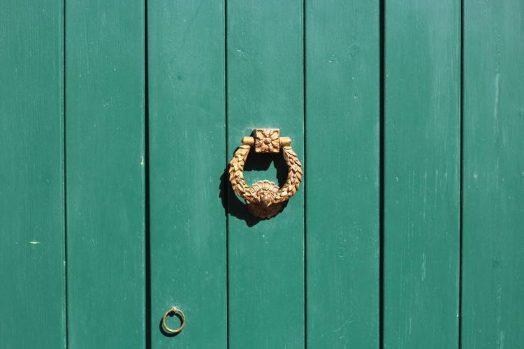 Close-up of green wooden door