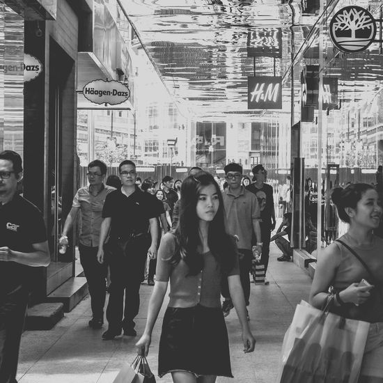 B&w Street Photography Casual Clothing City Life Friendship Front View Full Length Leisure Activity Lifestyles Men Occupation Real People Showcase: December Sitting Standing Street Togetherness Walking Women Young Adult Young Women