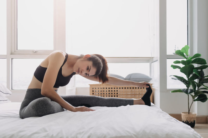 Woman relaxing on bed at home