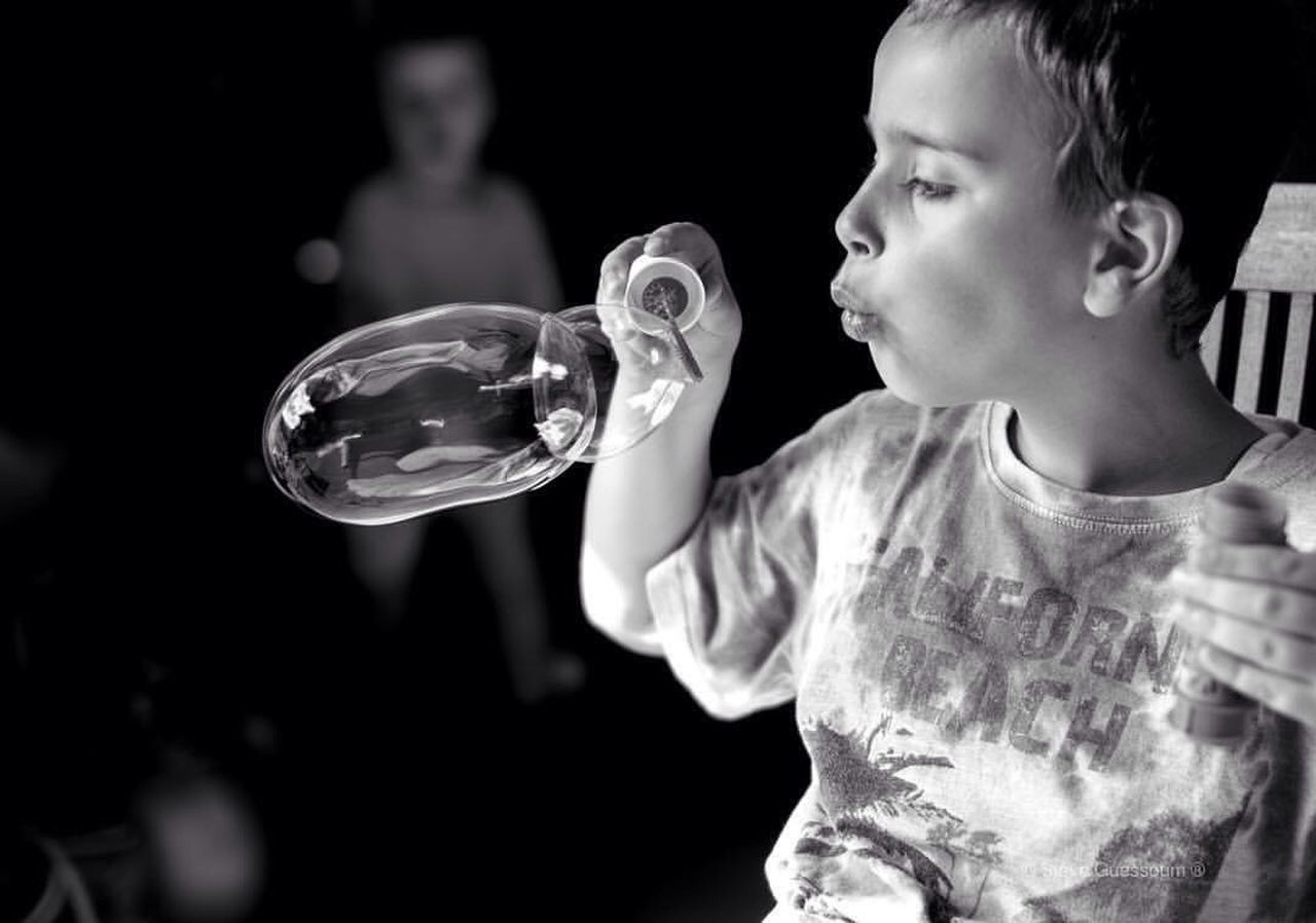 childhood, one person, holding, boys, focus on foreground, real people, bubble wand, leisure activity, lifestyles, fragility, outdoors, day, close-up, people