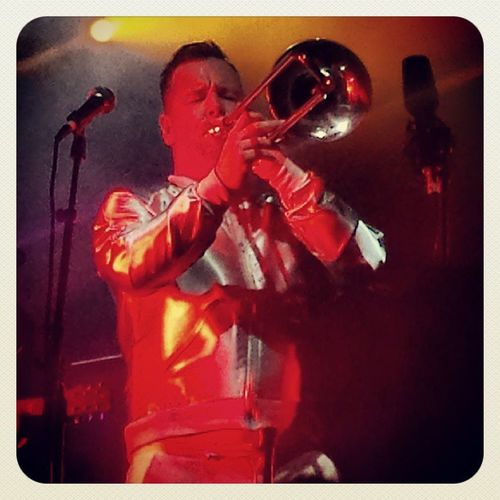 The trombonist from Fat Freddy's Drop doing his thing in a wicked silver jacket before stripping off to vest and pants.