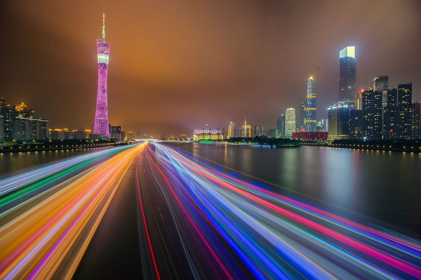 Night Illuminated City Tower Light Trail Skyscraper Architecture Building Exterior Urban Skyline Cityscape Travel Destinations Built Structure Speed Modern Multi Colored Outdoors No People Sky 好心情(1)