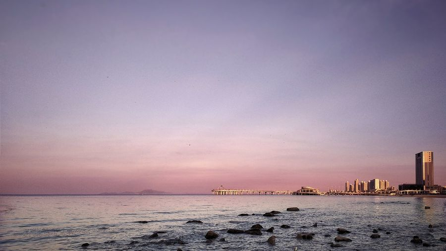 Excellent Skyline Water Sea Sunset Beach Low Tide Sand Blue Sky Horizon Over Water Architecture Seascape Calm Ocean Romantic Sky Office Building Dramatic Sky Rushing
