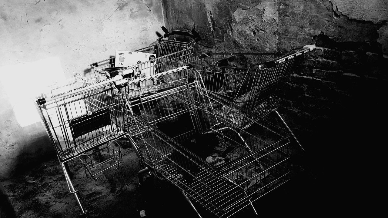 abandoned, no people, architecture, high angle view, decline, run-down, built structure, damaged, deterioration, day, bad condition, shopping cart, obsolete, metal, accidents and disasters, outdoors, ruined, industry, building exterior, nature