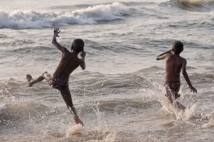 Playing with waves at the Mahabalipuram beach in the state of Tamil Nadu India. People Travel Streetphotography Storytelling Documentary Mahabalipuram, India India Beach Water Land Fun Leisure Activity Child Enjoyment Real People
