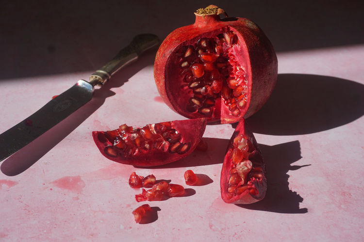 pomegranate Pomegranate Pomegranate Seed Seeds Seed Fruit Fruits Red Red Color Healthy Eating Vitamin Antioxidant Still Life StillLifePhotography Food Food And Drink Pomegranate Pomegranate Seed Fruit Red Celebration Close-up Kitchen Knife Halved Cutting Board Juicer Whole SLICE Cutting Knife Cross Section