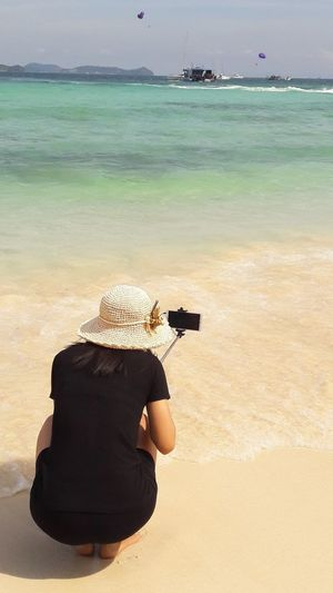 Looking Sea Beach Sand Full Length Rear View Swimming Water Sky Landscape Photographer Horizon Over Water Digital Camera Sun Hat Photographic Equipment