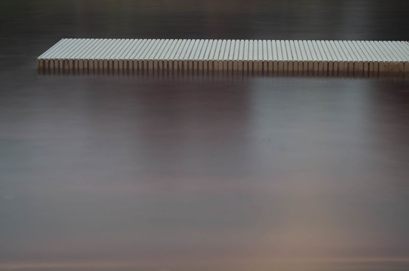 Absence Blurred Motion Close-up Day Flooring Growth High Angle View Indoors  Long Exposure Motion Nature No People Pattern Reflection Repetition Selective Focus Still Life Table Wood - Material