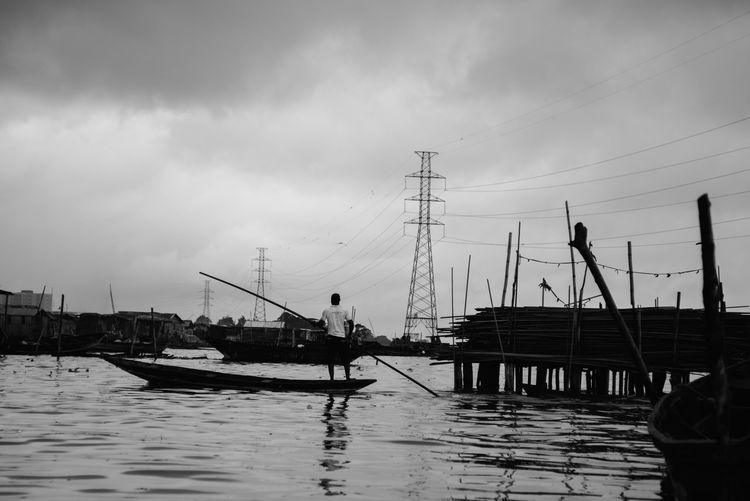 Sky and refections Nigeria TheWeekOnEyeEM Cloud - Sky Day Fisherman Fishing Boat Harbor Men Mode Of Transportation Moored Nature Nautical Vessel Occupation One Person Outdoors Real People Sailboat Sea Sky Transportation Travel Water Waterfront