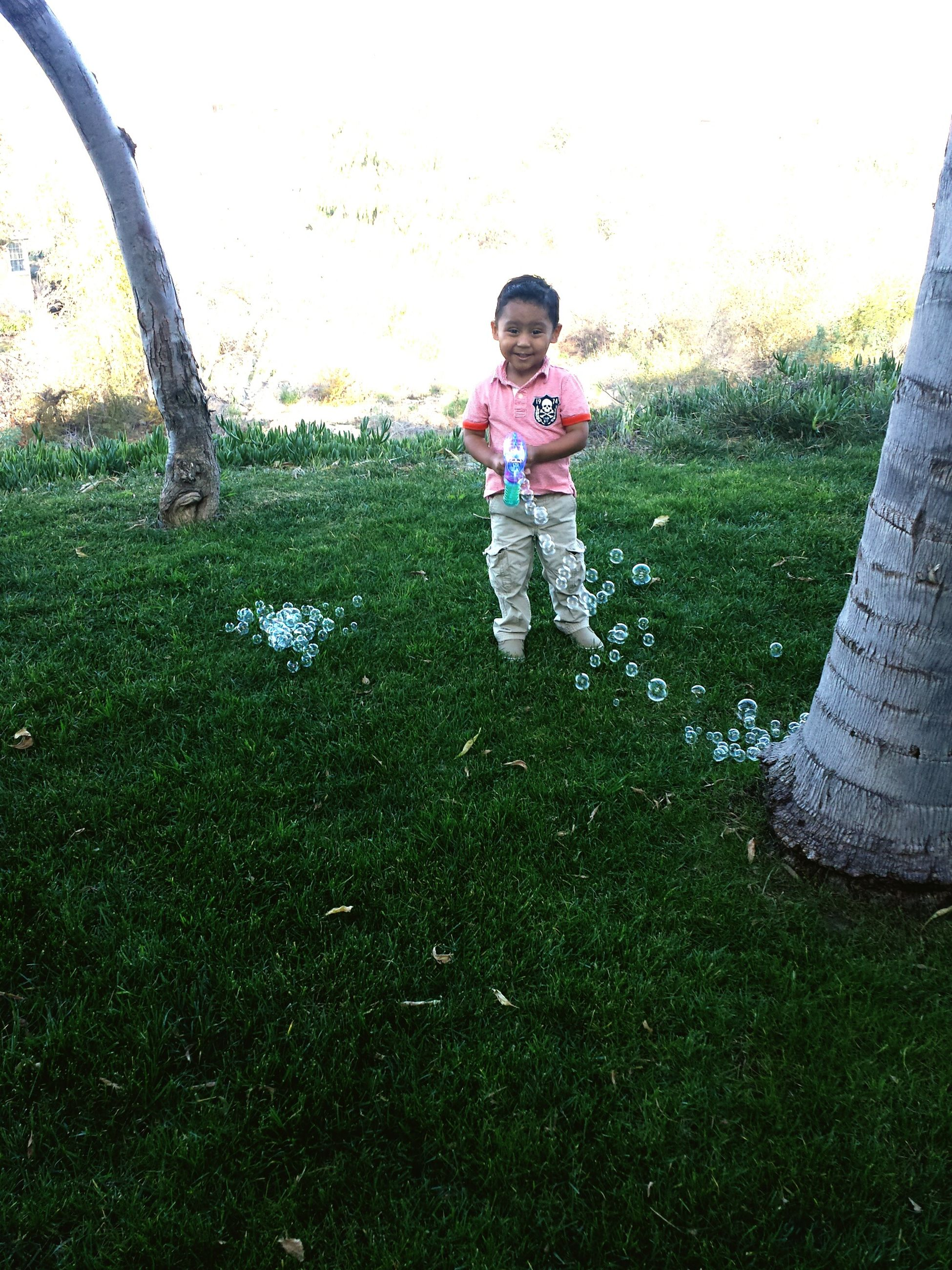 childhood, elementary age, grass, full length, boys, lifestyles, casual clothing, person, leisure activity, girls, innocence, cute, park - man made space, field, standing, grassy, smiling, playful