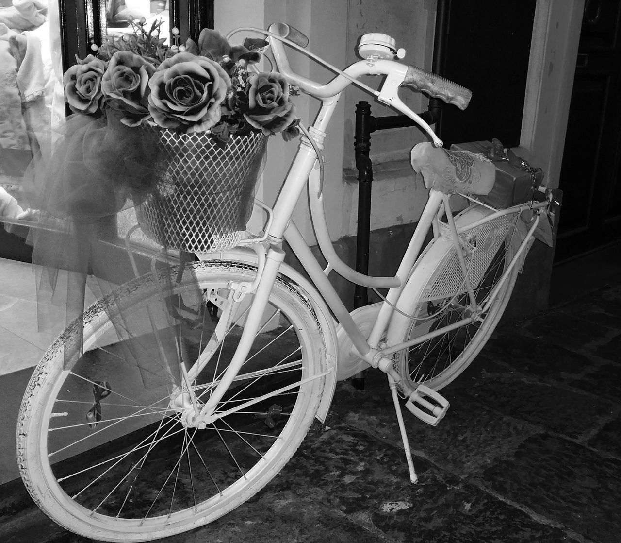 CLOSE-UP OF BICYCLE IN BASKET