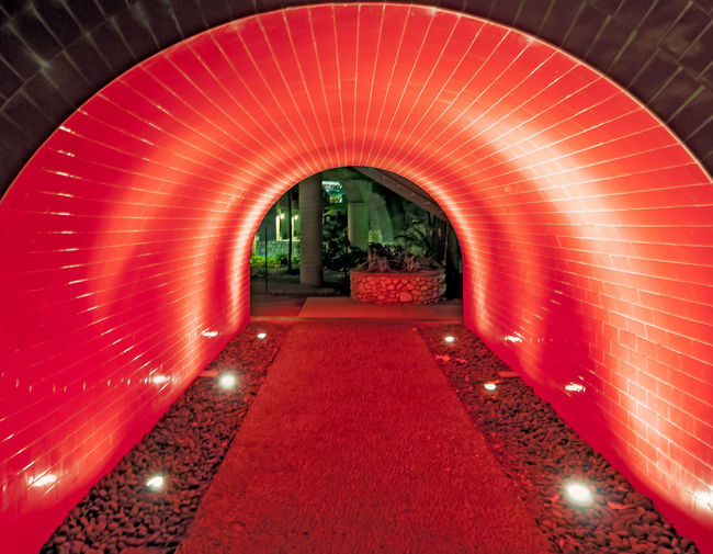 Arch Architecture Brick Diminishing Perspective Empty From My Point Of View Illuminated Illumination Leading Lines Light In The Darkness Lights No People Perspective Red Red Red Color River Walk River Walk At San Antonio The Way Forward Tunnel Tunnel View Vanishing Point Walk This Way Walk Through Walkway