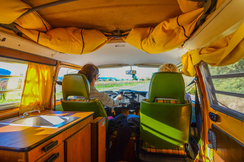 Young couple driving camper