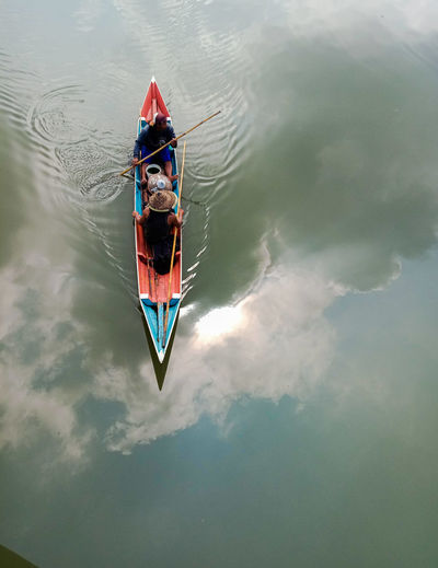 High angle view of people sailing in boat at lake