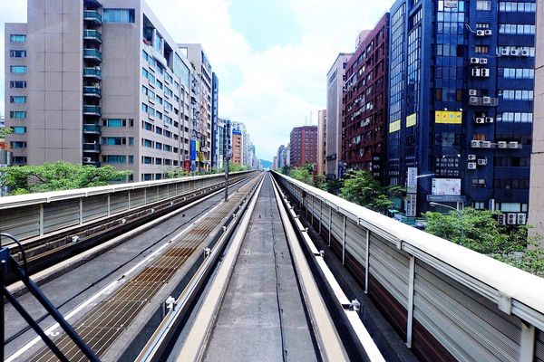 What does the future hold? Architecture Railroad Track Transportation Building Exterior Skyscraper Modern Sky Day Future Taiwan Train Tracks EyeEmNewHere EyeEm Diversity Art Is Everywhere Break The Mold Lost In The Landscape Perspectives On Nature