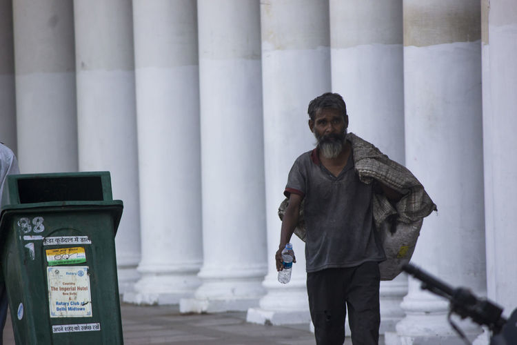 the first picture is taken during a streetplay while the other is of a garbage collector during his morning duties. ConnaughtPlace Delhi Drama Mannequin Morning Streetphotography Streetplay Students