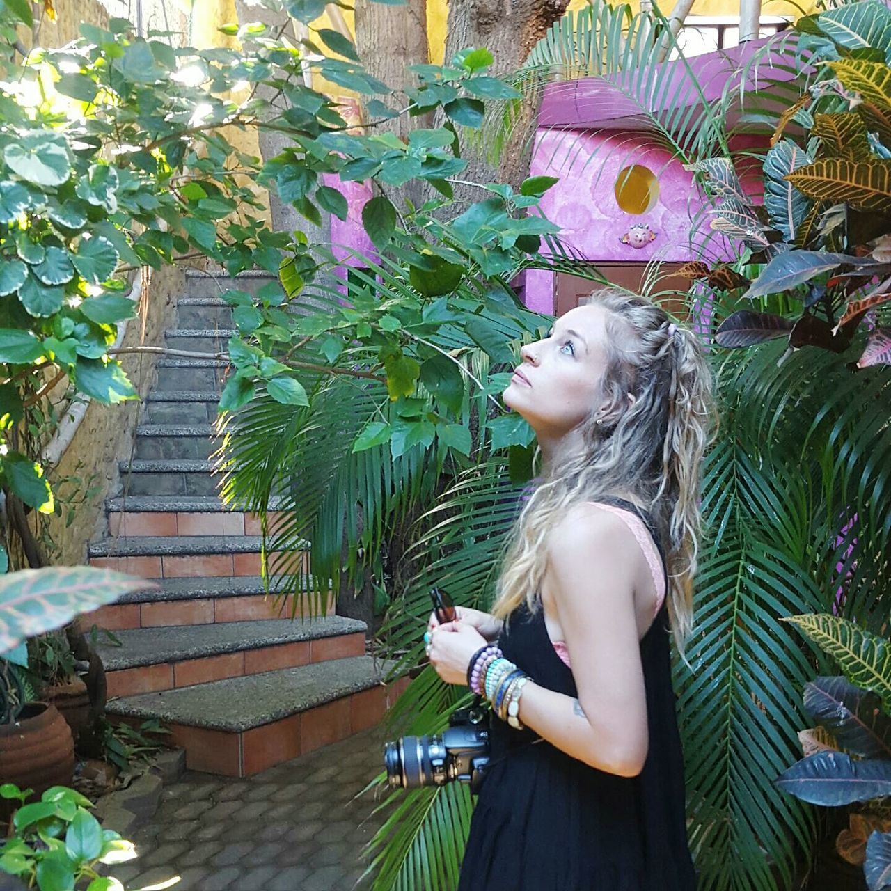 one person, young women, young adult, real people, outdoors, side view, plant, lifestyles, day, standing, beautiful woman, people