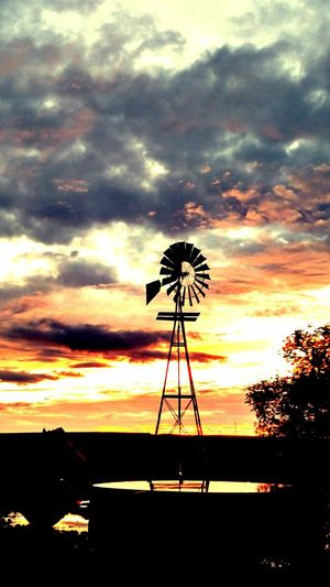 Sun sets and windmills Sunset Silhouette Scenics Cloud - Sky Dramatic Sky Moody Sky Beauty In Nature Sky Fuel And Power Generation Tranquil Scene Atmosphere Water Tranquility Atmospheric Mood Cloud Nature Environmental Conservation Majestic Windmill Outdoors First Eyeem Photo