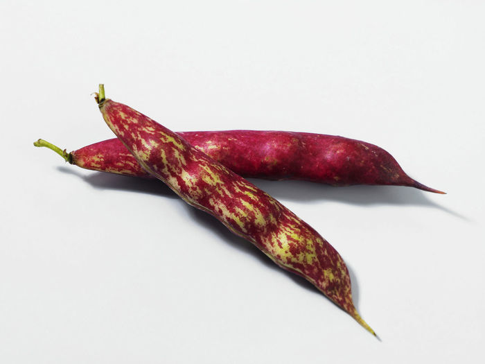 group of borlotti beans over white background Borlotti Beans Close-up Copy Space Cut Out Food Food And Drink Freshness Healthy Eating Indoors  Ingredient No People Nourishment Nutrition Produce Red Ripe Single Object Still Life Studio Shot Vegetable Wellbeing White Background