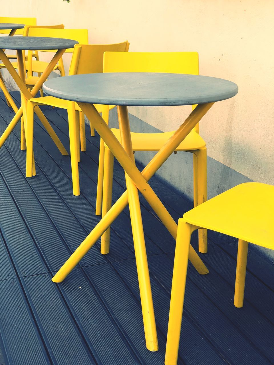 seat, chair, table, yellow, absence, wood - material, empty, no people, furniture, flooring, indoors, cafe, wood, high angle view, still life, day, restaurant, arrangement, close-up, setting