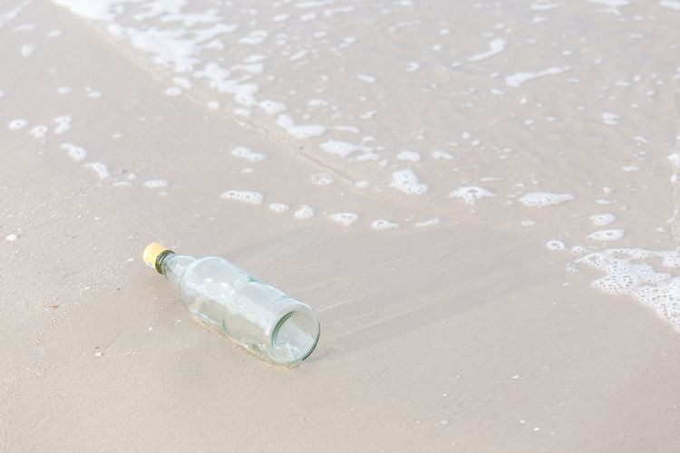 High angle view of bottle on beach