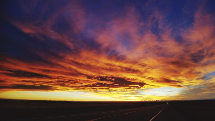 Road Sunset Landscape Transportation Scenics No People Nature Cloud - Sky Outdoors Travel Destinations Road Trip Beauty In Nature Day Sky Dramitic Sky