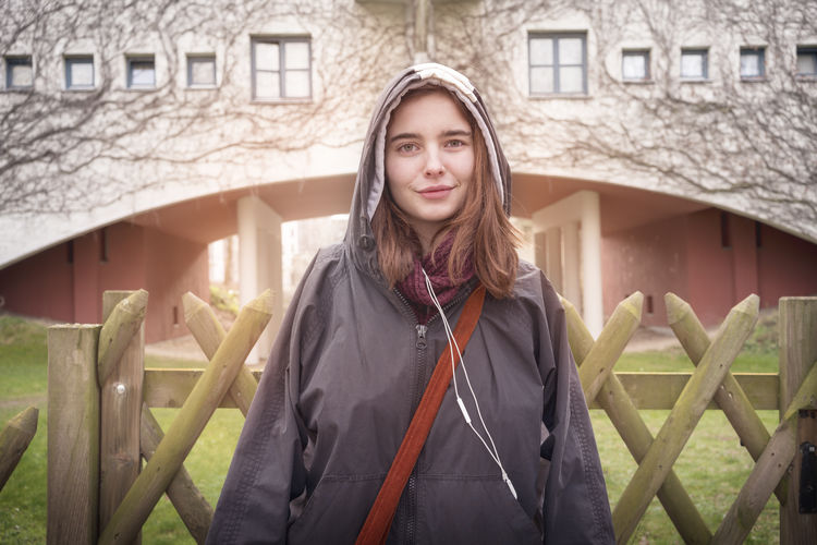 Portrait of smiling young woman standing in winter