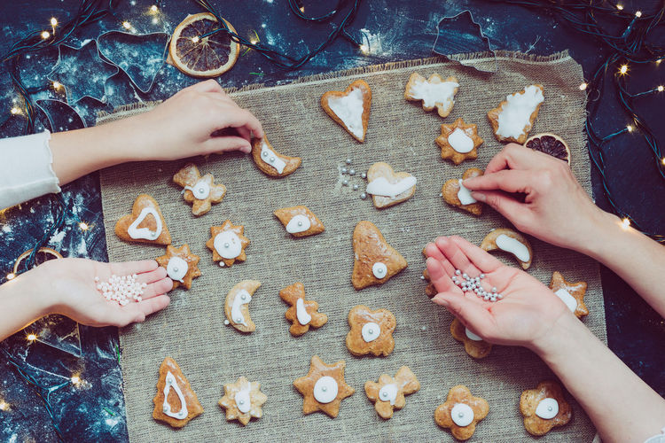 Close-Up Of Hands Making Christmas Cookies