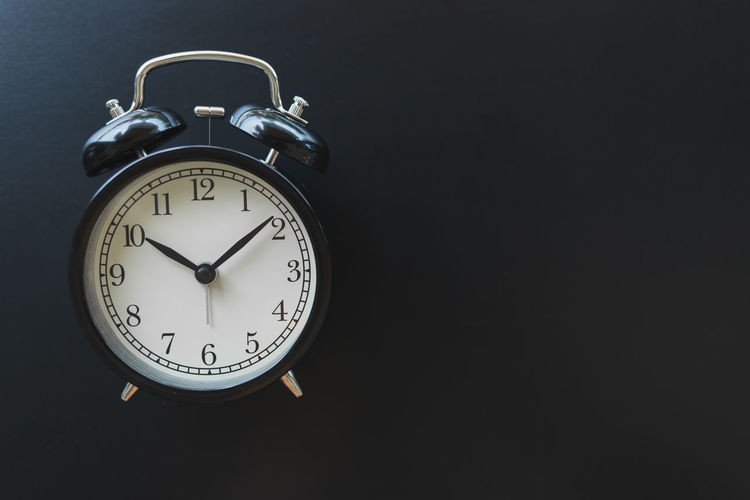 Close-up of clock against black background