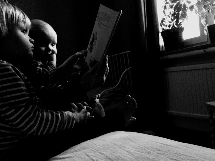 Blackandwhite Childhood Reading Books Book Children's Book Girl Boy Parenthood EyeEm Best Shots Black And White Collection  Blackandwhite Photography Window The Moment - 2016 Eyeem Awards