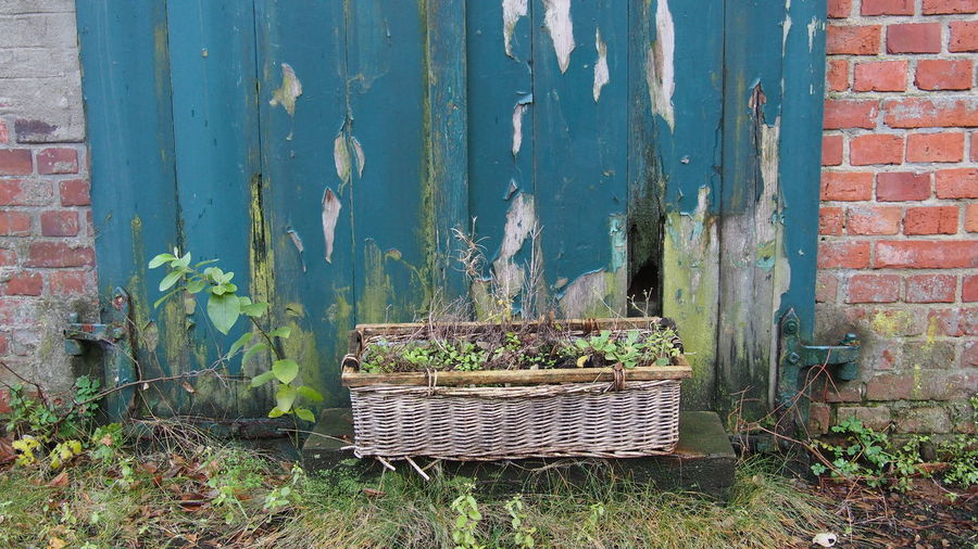 Old Window Box Against Weathered Wooden Fence