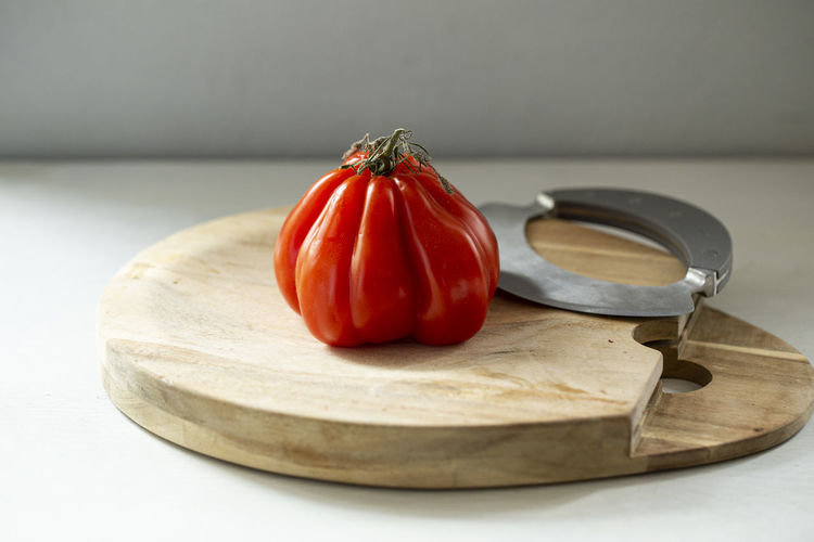 Close-up of red bell peppers in plate on table