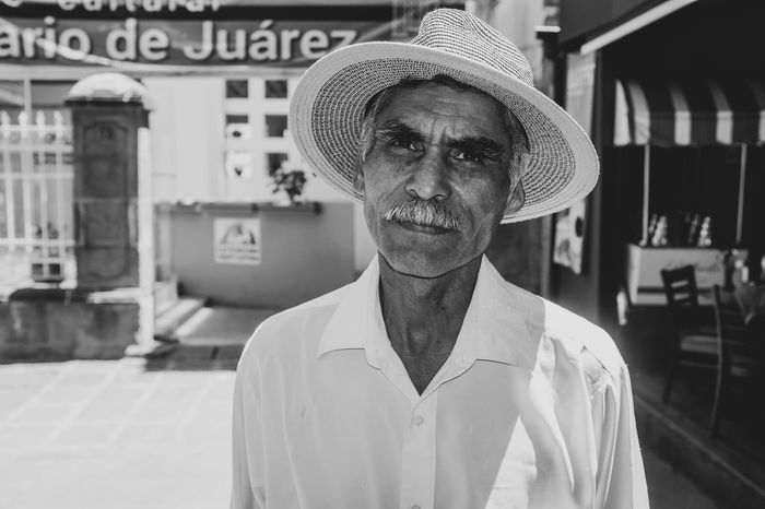 A black and white street portrait EyeEm Best Shots EyeEm Selects Mexico PortraitPhotography Portraits Beard Black And White Photography Hat Hombre Looking At Camera Mature Adult Mature Men Mexican Mustache One Person Portrait Portrait Photography Real People Shirt Street Street Photography Streetphoto_bw Streetphotography Week On Eyeem White Shirt The Portraitist - 2018 EyeEm Awards The Portraitist - 2018 EyeEm Awards
