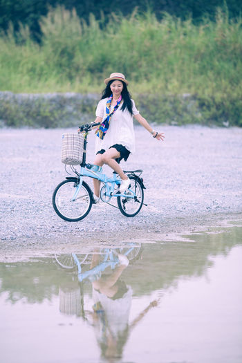 Asian Girl On A Bike In The Countryside Asian  Attractive Bicycle Bike Chinese Countryside Cycling Eauty Female Field Girl Happy Healthy Lifestyle Model Nature One Person People Portrait Pretty Smile Student Vacation Woman Young