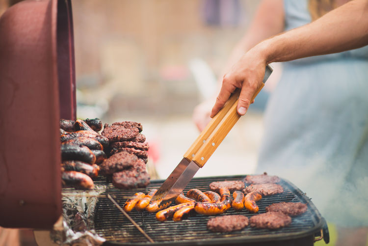 Barbecue Barbecue Grill Focus On Foreground Food Food And Drink Freshness Grilled Hand Heat - Temperature Holding Human Body Part Human Hand Meat Men One Person Outdoors Preparation  Preparing Food Real People Serving Tongs