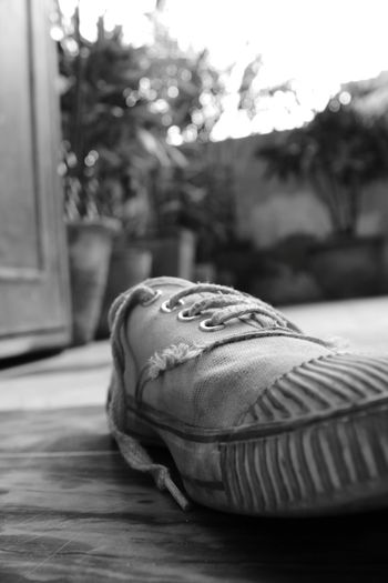 Every Shoe Has Its  Own Story.... Shoelace Shoelfie OldShoes Showcase March Random Objects Selective Focus Selfie ✌ Blackandwhite Photography Blackandwhite Found On The Roll Tennis Shoes Old Memories School Memories