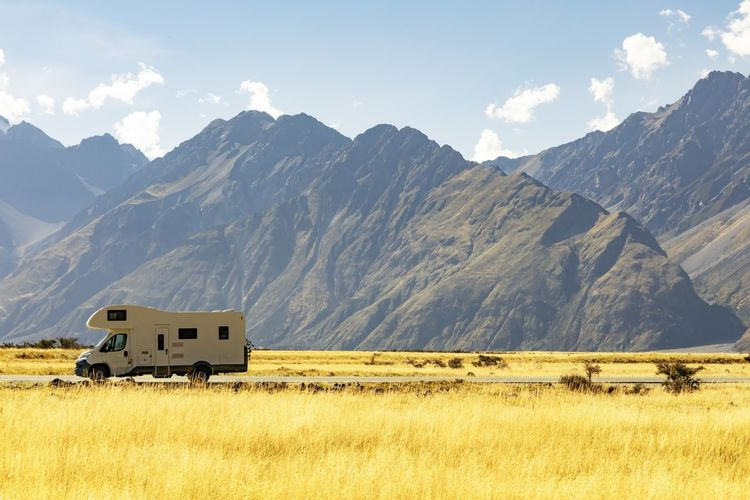 Motor home on road against mountains