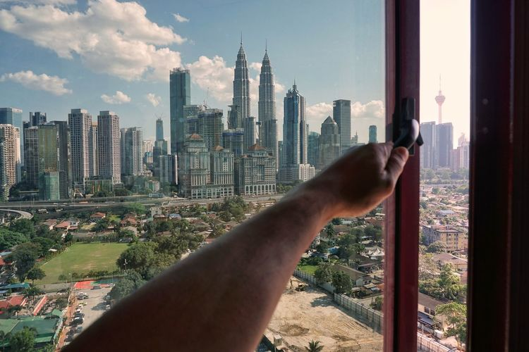 Hand open the window Kuala Lumpur Malaysia Skyline Window Skyscraper Cityscape Human Hand Human Body Part Business Finance And Industry City Urban Skyline Downtown District Architecture Day Sky Building Exterior Outdoors