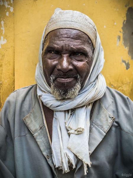 Dakar Elderly Man Eyes Headscarf Headshot Jacket Mosque Muslim Person Scarf Senegal