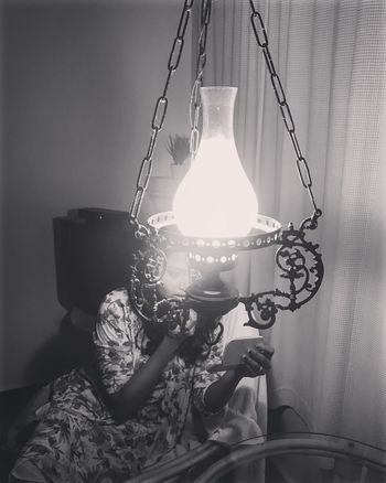 Lighting Equipment Hanging Electric Lamp Illuminated Indoors  Lamp Shade  Chain Electricity  Night Love Without Boundaries EyeEmNewHere Indoors  Old-fashioned Her Beautiful Woman Absence Togetherness Diva Makeup Make Magic Happen EyeEm Best Shots Eyeemphoto Close-up Capture Tomorrow