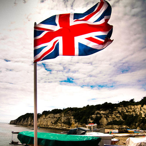Beach Scene  Boat Boat With Flag British Cloud - Sky Culture Day Devon England English English Beach Scene Flag Great Britain Flag Identity National Flag Outdoors Patriotism Pole Sky Union Jack Union Jack Flag