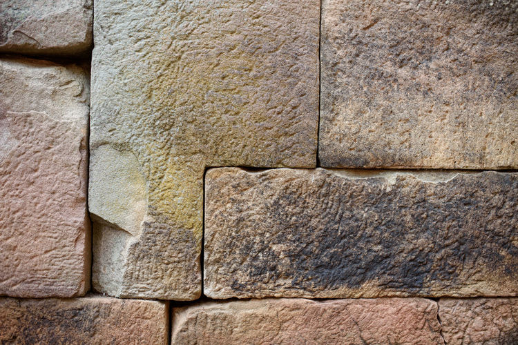 Ancient Ancient Civilization Architecture Backgrounds Built Structure Close-up Concrete Craft Day Full Frame History No People Old Outdoors Pattern Rough Sandstone Solid Stone Material Stone Wall Textured  Textured Effect The Past Wall Wall - Building Feature