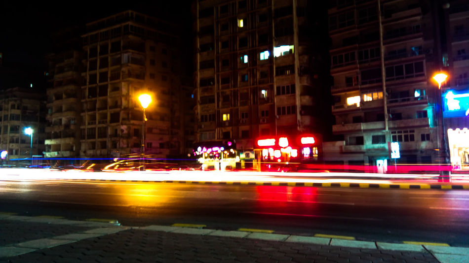 Night Illuminated Car Building Exterior Street Architecture City Street City Built Structure City Life Street Light Transportation Road Outdoors Land Vehicle Cityscape No People EyeEm Selects Mobile Photography Light City Low Angle View Cityscape