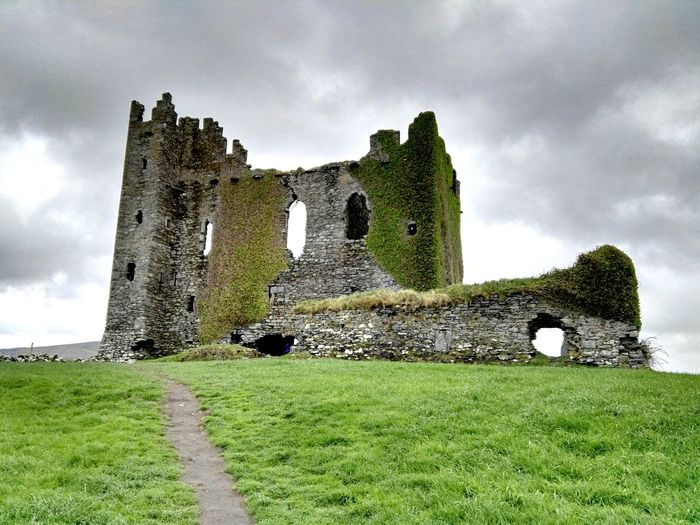 Low angle view of ballycarbery castle against sky