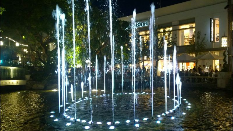 The Grove  Water Fountain Water Night Shops People Dining