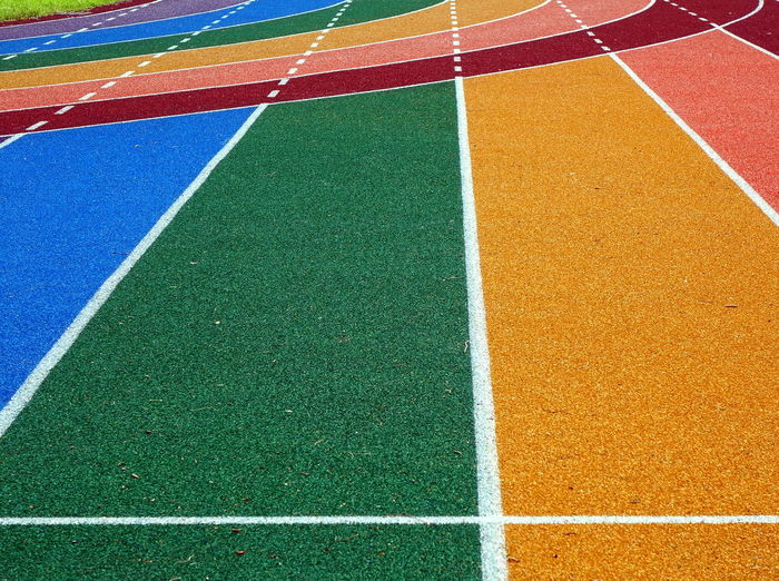 Athletic running tracks in bright colors Blue Color Curve Green Color Athletic Track Markings Multi Colored Orange Color Polyurethane Rubberizing Running Track Sport Sports Track Stadium