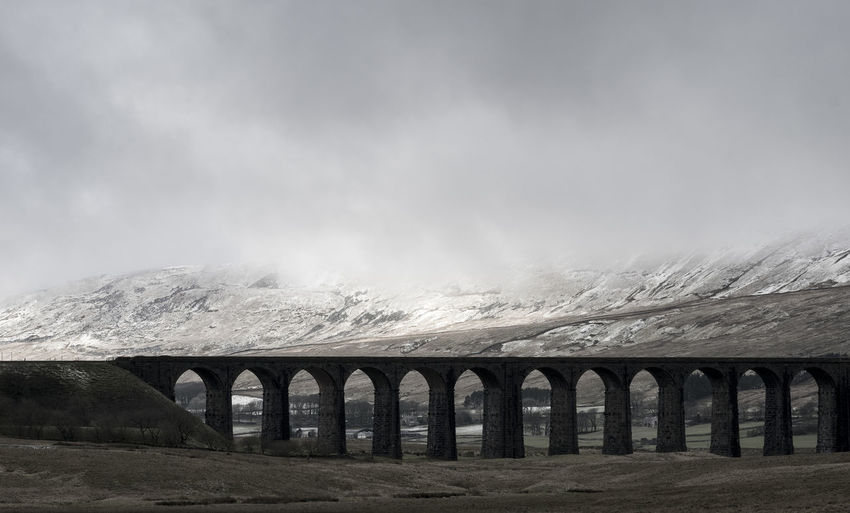 Winter Arch Architecture Bridge - Man Made Structure Built Structure Cloud - Sky Connection Mountain Scenics Snow Transportation Viaduct Yorkshire Dales