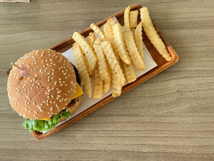 Fast Food Unhealthy Eating Food Ready-to-eat Food And Drink Prepared Potato Sandwich French Fries Burger Potato Freshness Table Bread Hamburger Still Life Fried Wood - Material High Angle View Indoors  Serving Size No People Snack Bun Take Out Food Meal