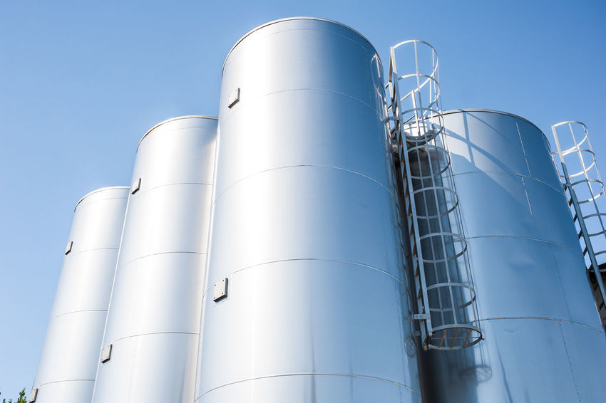 Industrial silos for chemical production, by stainless steel Factory Industrial Industry No People Outdoors Silos Sky Stainless Staircase Steel Storage Storage Tank Tank Warehouse